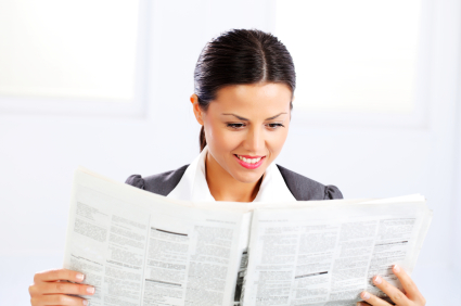 business woman reads a newspaper