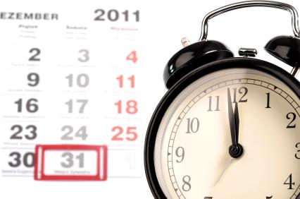 stock photo 18528255 old black alarm clock with calendar