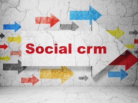 business concept arrow with social crm on grunge textured concrete wall background