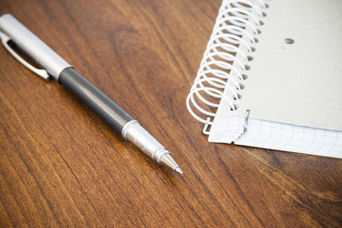 shutterstock 213614002 pen and coiled notebook