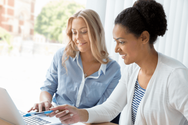 two women working together shutterstock 262915874