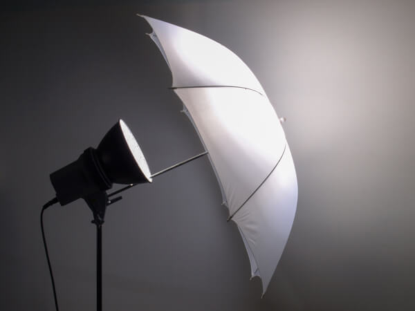 A photo umbrella helps create soft, flattering light for your videos.