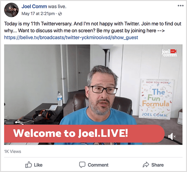 Joel Comm appears in a live video from his office. The walls are bare and white, and a poster showing the cover of The Fun Formula leans against a wall in the background. Joel wears a blue t-shirt and glasses. A lower-third caption says Welcome to Joel.LIVE!