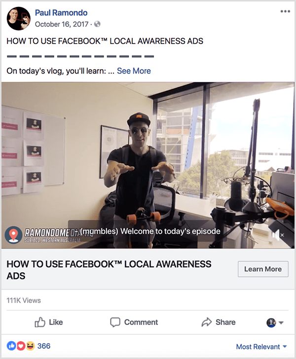 Paul Ramondo vlog posted to Facebook has the text How to Use Facebook Local Awareness Ads. Below this title is the text On Today's Vlog, You'll Learn . . . The video shows Paul standing behind an L-shaped desk in a window office. He's wearing a baseballcap and black t-shirt.