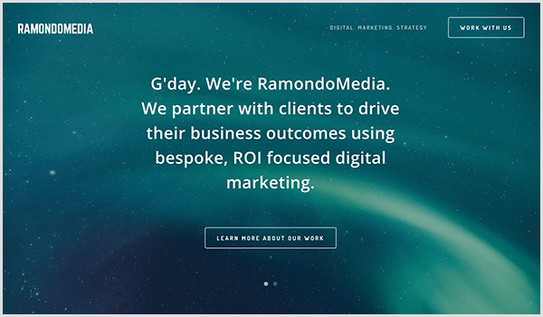 The RamandoMedia website has a dark blue background with stars and streaks of light. Over the picture, white text and a button appears. The text says G'day. We're RamondoMedia. We partner with clients to drive their business outcomes using bespoke, ROI-focused digital marketing. The button text says Learn More About Our Work.