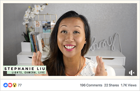 "This is a screenshot of Stephanie Liu in a Facebook live video. Viewers can see Stephanie from the shoulders up. Stephanie is an Asian woman with black hair hanging just below her shoulders. She's smiling and wearing makeup and a white shirt with a peach and black abstract pattern. In the lower left, on a light green background is the black text ""Stephanie Liu, Lights Camera Live"". The background for her live video is a gray room with a white desk. On the desk are books and a white orchid in a square white pot. A white neon sign that spells ""hey"" is also sitting on the desk, and it's turned off. The live video has 77 reactions, 196 comments, 22, shares, and 1.7K views."