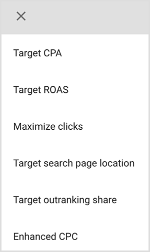 This is a screenshot of a menu of targeting options in Google Ads. The options are Target CPA, Target ROAS, Maximize clicks, Target search page location, Target outranking share, Enhanced CPC. Mike Rhodes says smart targeting options in Google Ads use artificial intelligence to find people with the right intent for your ad.