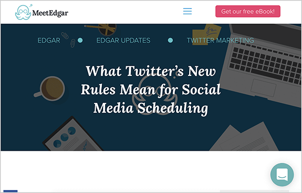 "This is a screenshot of a blog post image from the MeetEdgar website. The image has a dark background with an overhead illustration of a coffee cup, an laptop, papers, and the MeetEdgar octopus logo. In white text over this image is the text ""What Twitter's New Rules Mean for Social Media Scheduling"". Above this image is the MeetEdgar octopus logo, a hamburger menu, and a pink button labeled ""Get Our Free Ebook!"". In the lower right is a chat icon."