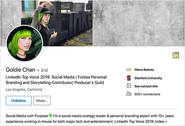 "This is a screenshot of Goldie Chan's LinkedIn profile. She's an Asian woman with green hair. In her profile photo, she's wearing makeup, a black choker necklace, and a black shirt. Her tagline says ""LinkedIn Top Voice 2018: Social Media 