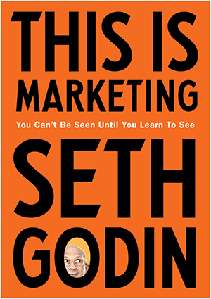 This is a screenshot of the cover of This Is Marketing by Seth Godin. The cover is a vertical rectangle with an orange background and black text. A photo of Seth's head appears in the O of his last name.