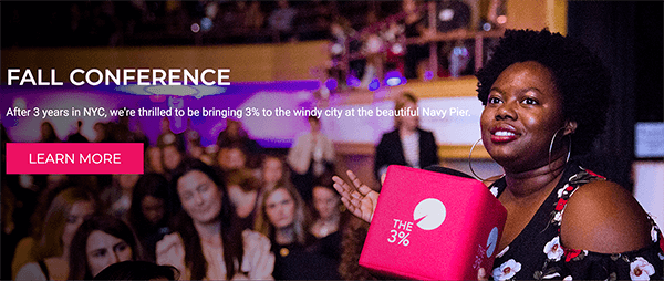 "This is a screenshot from the website for The 3% Conference. In an photo, a black woman holds a bright pink cube with the conference logo printed on it. Behind her is a crowd of women at the conference. The white text over the image says ""After 3 years in NYC, we're thrilled to be bringing 3% to the windy city at the beautiful Navy Pier."" A bright pink button says ""Learn More"". Melissa Cassera says this conference is an example of a business with a quest story."
