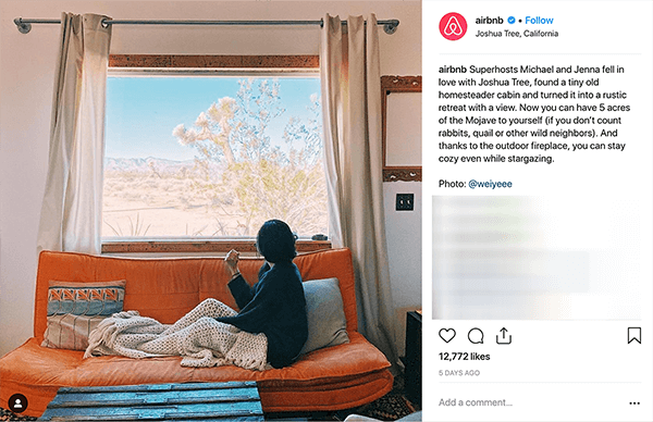 This is a screenshot of an Instagram post from Airbnb. It tells the story of a couple who hosts people at their home through Airbnb. In the photo, someone sits on an orange couch under a beige knitted throw blanket and looks out the window at a desert landscape. Melissa Cassera says these stories are an example of a business using the overcoming the monster plotline in its social media marketing.