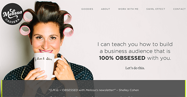 "This is a screenshot of Melissa Cassera's website. Her logo appears in the upper left. On the left side of the page is photo of Melissa. She's a white woman with dark hair, smiling and drinking a cup of coffee. She's wearing large rollers in her hair and a dark blue pajama top with small white polka dots. On the right is the text ""I can teach you how to build a business audience that is 1005 OBSESSED with you. Let's do this."""