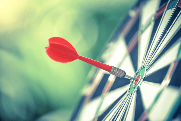 10 metrics to track when analyzing your social media marketing, stock photo of dart which has hit bulls-eye