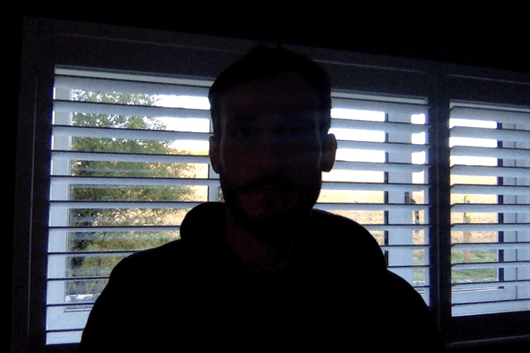 silhouette effect created when subject of video is standing in front of window