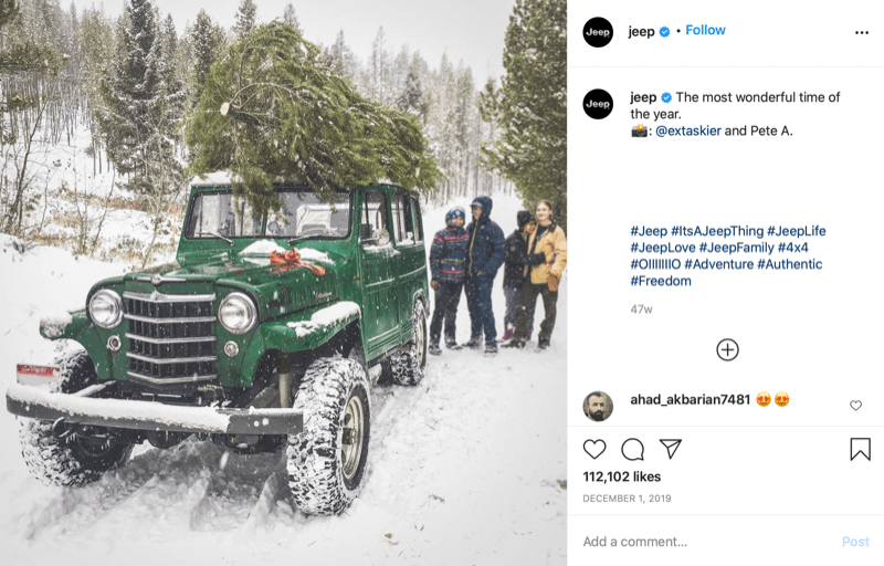 instagram post from @jeep showing a family at the end of christmas tree hunting with a tree on the top of their jeep, deep in snow and tree country